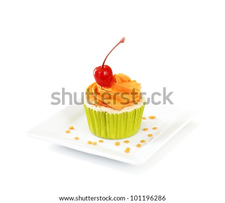 Vanilla cupcake with vanilla frosting topped with a maraschino cherry, on white background. - stock photo