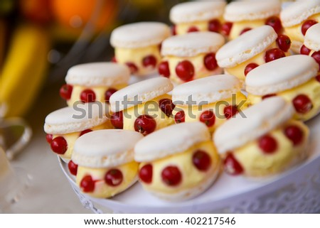 Vanilla cupcakes with cranberry in natural light - stock photo