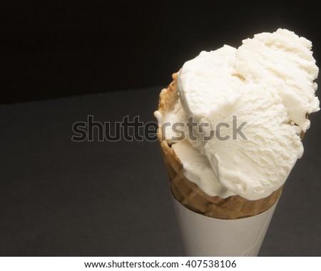 Vanilla Ice Cream in a cone/Ice Cream Cone/ Multiple scoops of ice cream in a cone - stock photo