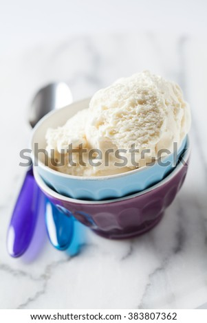 Vanilla ice cream in bright bowls