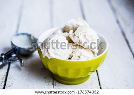 Vanilla ice-cream on white background - stock photo