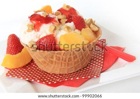 Vanilla Ice cream sundae with strawberry and peaches. - stock photo