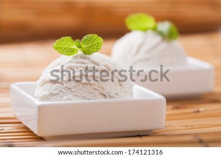Vanilla ice cream with fresh mint - stock photo