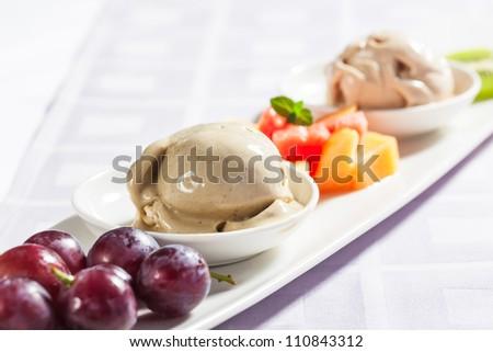 Vanilla Ice cream with red grapes. - stock photo