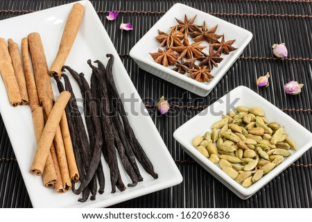 Vanilla pods, cinnamon stick, cardamom and star anise - stock photo