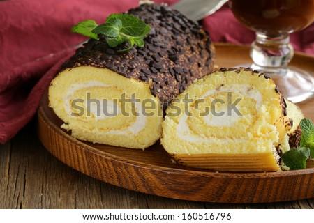 vanilla roll cake with chocolate ganache and  creamy cream - stock photo