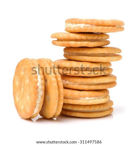 vanilla sandwich cookies on white background - stock photo