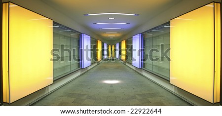 vanishing perspective of alleyway with square orange lights - stock photo