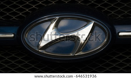 VANTAA, FINLAND, May 21st: A glistening Hyundai Logo on the front of the car.