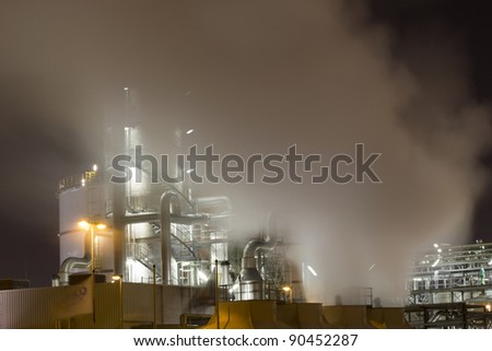 Vapour-emissions deriving from an oil-refinery plant - stock photo