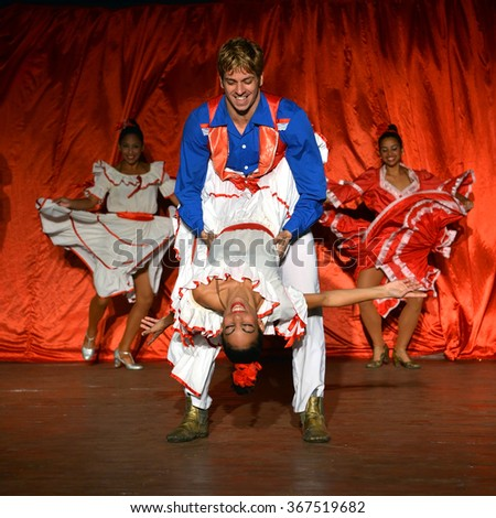 VARADERO, CUBA - JANUARY 20, 2016:  Entertainment staff at the Melia Las Antillas resort perform dance for tourists. - stock photo