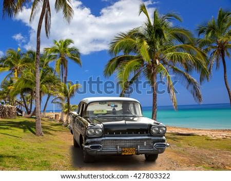 VARADERO, CUBA - MAY, 22, 2013: Black american classic car on the beach - stock photo