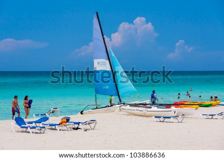 VARADERO,CUBA-MAY 26:Tourists enjoying the beach May 26,2012 in Varadero.With over a million visitors per year,Varadero is the most important destination for the growing cuban tourism industry - stock photo