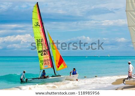 VARADERO,CUBA-NOVEMBER 3:Tourists sailing on a catamaran November 3,2012 in Varadero.With over a million visitors per year,Varadero is the destination of more than 40% of tourists visiting the island - stock photo