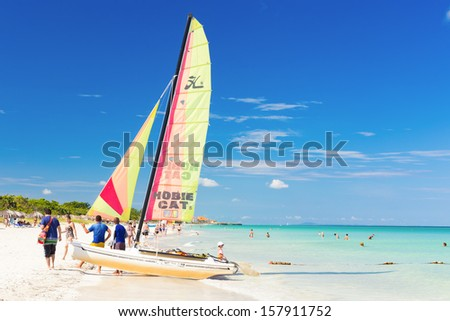 VARADERO,CUBA-OCTOBER 6:Tourists sailing on a catamaran October 6,2013 in Varadero.With over a million visitors per year,Varadero is the destination of more than 40% of tourists visiting the island - stock photo
