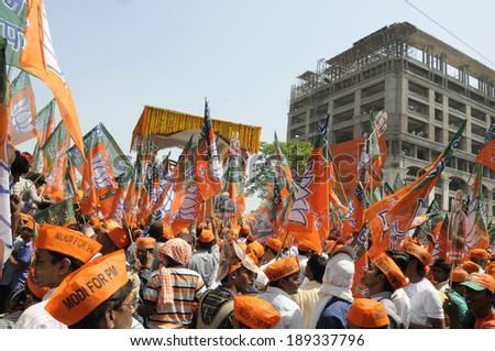VARANASI-APRIL 24: Followers of Narendra Modi  participating in  a rally in his support  on April  24, 2014 in Varanasi , India. - stock photo