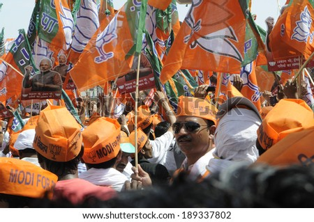 VARANASI-APRIL 24: Supporters of all ages with flags and saffron caps participating in a political rally in support of Mr. Narendra Modi on April  24, 2014 in Varanasi , India.  - stock photo