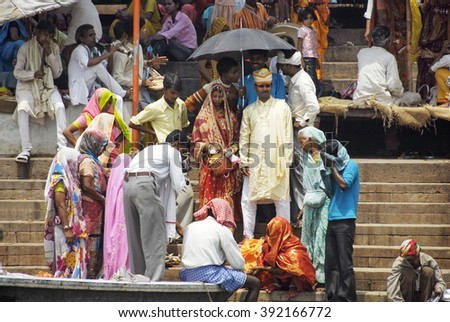 VARANASI, INDIA - APRIL 30: Unidentified Indian bride and groom on ghat during wedding ceremony in Varanasi, India, April 30, 2009. Traditionally, all Indian newlyweds pay a visit to The Ganges River.