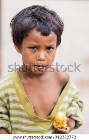 VARANASI, INDIA - AUGUST 2, 2015: Unidentified beggar child on the street in Leh, Ladakh. Poverty is a major issue in India. - stock photo
