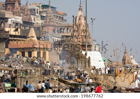VARANASI, INDIA - DECEMBER 2, 2012 : Indian people burning corpses and then drown them in the Ganges in Varanasi, India. River Ganges is regarded by Hindus as Holy. - stock photo
