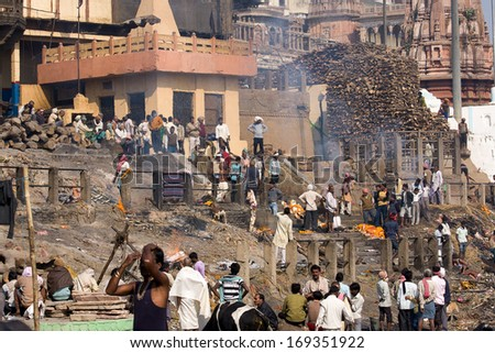 VARANASI, INDIA - DECEMBER 2: Indian people burning corpses and then drown them in the Ganges on December 2, 2012 in Varanasi, India. River Ganges is regarded by Hindus as Holy. - stock photo