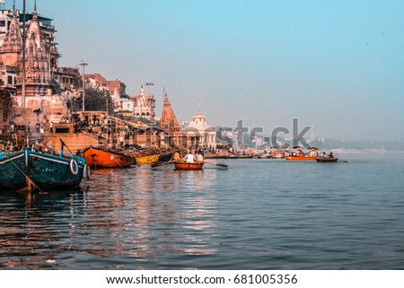 Varanasi, India - December 2016: Temple along the embankment, ghats and ancient buildings.
