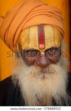 VARANASI - INDIA - DECEMBER 15, 2015: Unidentified sadhu (holy man) on the ghats of Ganges on December 15, 2015 in Varanasi, India. Varanasi is the holiest of the seven sacred cities in India. - stock photo