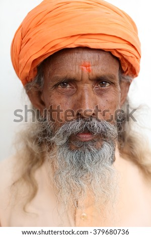 VARANASI - INDIA - DECEMBER 21, 2015: Unidentified sadhu (holy man) on the ghats of Ganges on December 21, 2015 in Varanasi, India. Varanasi is the holiest of the seven sacred cities in India.