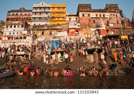 VARANASI, INDIA - FEBRUARY 20: Hindu pilgrims take holy bath in the river ganges on the auspicious Maha Shivaratri festival on February 20, 2012 at Dasashwamedh ghat in Varanasi, Uttar Pradesh, India