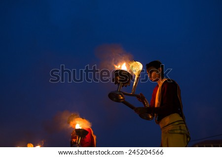 VARANASI, INDIA-19 JAN:A Hindu priest performs the Ganga Aarti ritual on 19 Jan, 2015 in Varanasi.Fire puja is a Hindu ritual that takes place at Assi Ghat on the banks of the river Ganges - stock photo