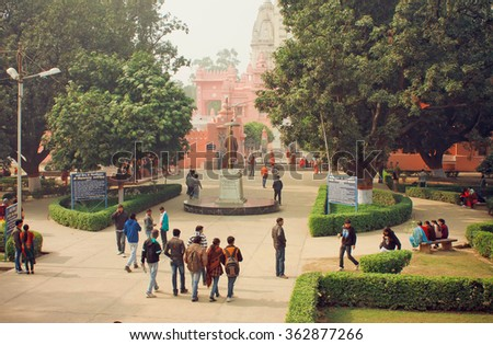 VARANASI, INDIA - JAN 3: Students go to campus through the park of Bannares Hindu University on January 3, 2013. The University is one of largest residential universities in Asia with 20,000 students - stock photo