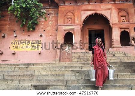 VARANASI, INDIA - JUNE 11: Portrait of old woman from Varanassi, June 11, 2008, India. Local women wear colorful saree (sari) as traditional clothing. - stock photo