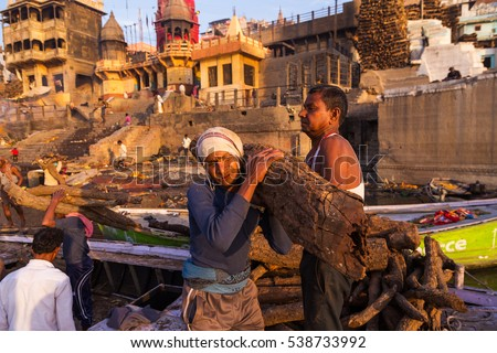 Varanasi, India - Mar 11, 2015:  Manikarnika Ghat is one of the ghats in Varanasi and is most known for being a place of Hindu cremation