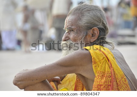 VARANASI, INDIA - NOVEMBER 22: An unidentified holy man arrives to the Ganges on November 22, 2010 in Varanasi, India. Hindus believe that to die there they can release the soul from the cycle of transmigrations. - stock photo