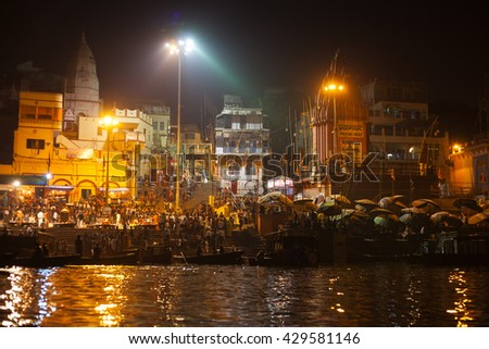 VARANASI, INDIA - NOVEMBER 25: Hindu people watching religious Ganga Aarti ritual (fire puja) from the water near Dashashwamedh Ghat on November 25, 2012 in Varanasi, Uttar Pradesh, Central India