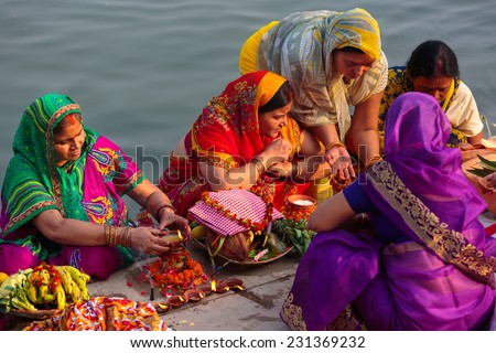 VARANASI,INDIA - October 29,2014 : Unidentified Indian women pray and devote for Chhath Puja festival on Ganges river side in Varanasi,India - stock photo