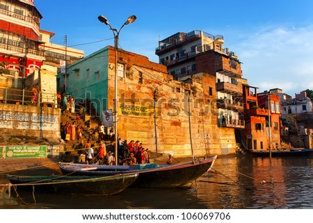 VARANASI, INDIA - SEPTEMBER 9 - Indian people wash away their sins in the stream of the sacred Ganges river on September 9, 2011. Hindus do this every morning. - stock photo