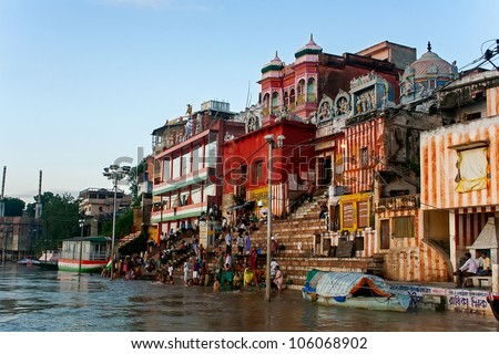 VARANASI, INDIA - SEPTEMBER 9 - Indian people wash themselves in the holy River Ganges on September 9, 2011. Hindus do this rite every morning. - stock photo
