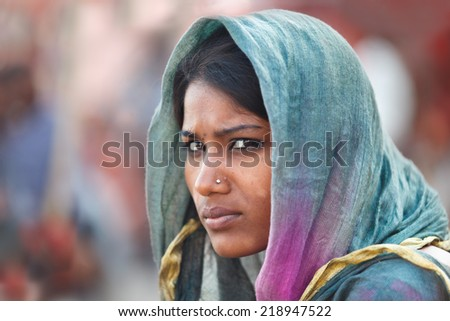 VARANASI, INDIA - 22/03/2013 : Unidentified young indian woman  with her colorful scarf.Scarf  made of indian silk is very common and popular among Indian woman,. - stock photo