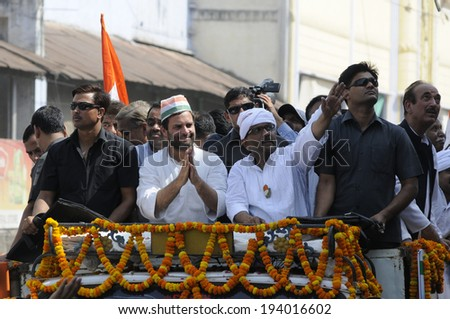 VARANASI - MAY 10: Rahul Gandhi acknowledging the people who came  to have a glimpse  of him during a road show  to support local Congress candidate Mr. Ajay Rai on May 10, 2014 in Varanasi , India. - stock photo