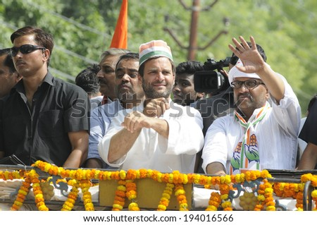VARANASI - MAY 10: Rahul Gandhi fixing his sleeves during a road show  to support local Congress candidate Mr. Ajay Rai on May 10, 2014 in Varanasi , India. - stock photo