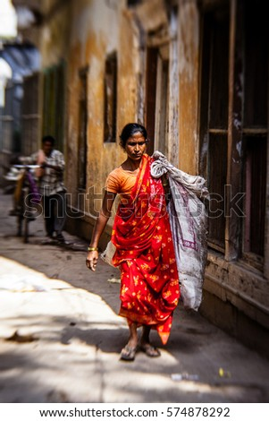 VARANASI - NOVEMBER 22: Unidentified hindu woman on the streets of sacred Varanasi old town on November 22, 2012 in Varanasi, State of Uttar Pradesh, India