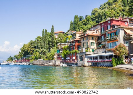 VARENNA, ITALY - 14 AUGUST, 2016: People walking by the Como lake. The city, founded by local fishermen in 769, is located 60 km from Milan.