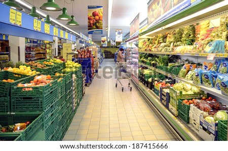 VARESE, ITALY-APRIL 11, 2014: Aisle of fruits and vegetables inside a supermarket in Varese. - stock photo