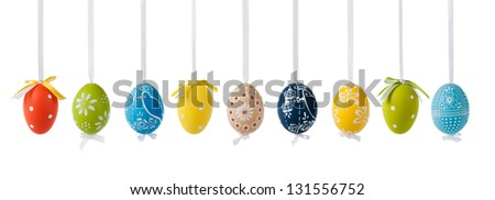 Variation of colorful easter eggs, hanging on white silk ribbons. Isolated on white. - stock photo