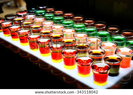 Variation of hard alcoholic shots served on bar counter. - stock photo