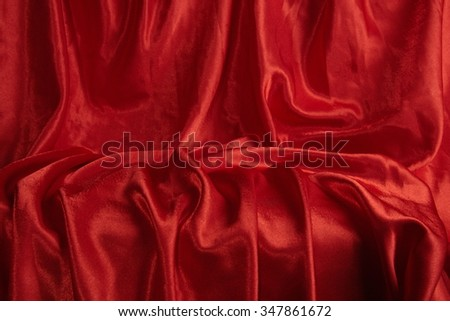 Variation of scene-background with red velvet with chaotic folds. - stock photo