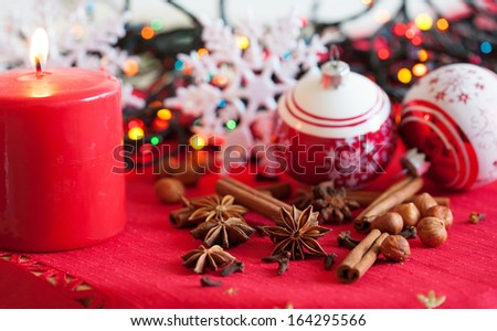 Variation of spices, Christmas decorations and a candle