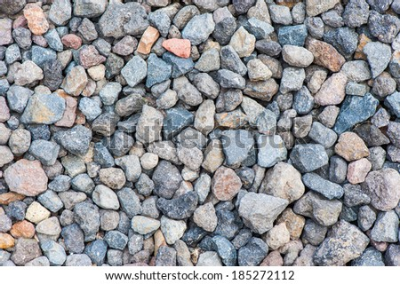 Varicolored gravel stone texture with small details - stock photo