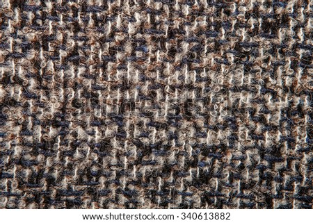 Varicolored tweed like texture, varicolored wool pattern, textured  melange upholstery fabric background copy space.  Background texture of twill - stock photo